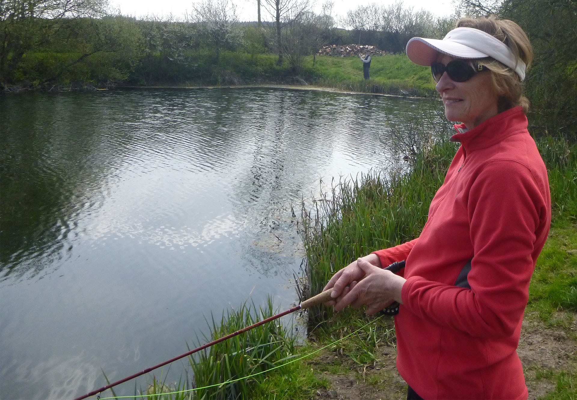 lady fishing pond